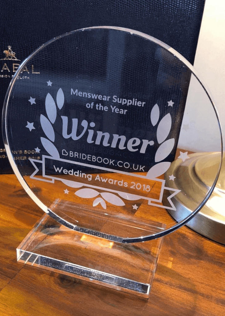 """A close up shot of the winning award of """"Menswear Supplier of the Year 2018"""" to Whitfield and Ward"""