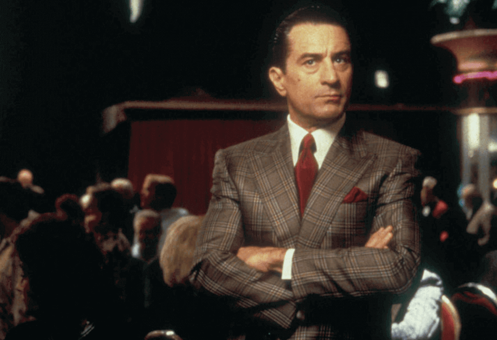650a6d44f4 Robert de Niro in Casino wearing a check suit and red tie