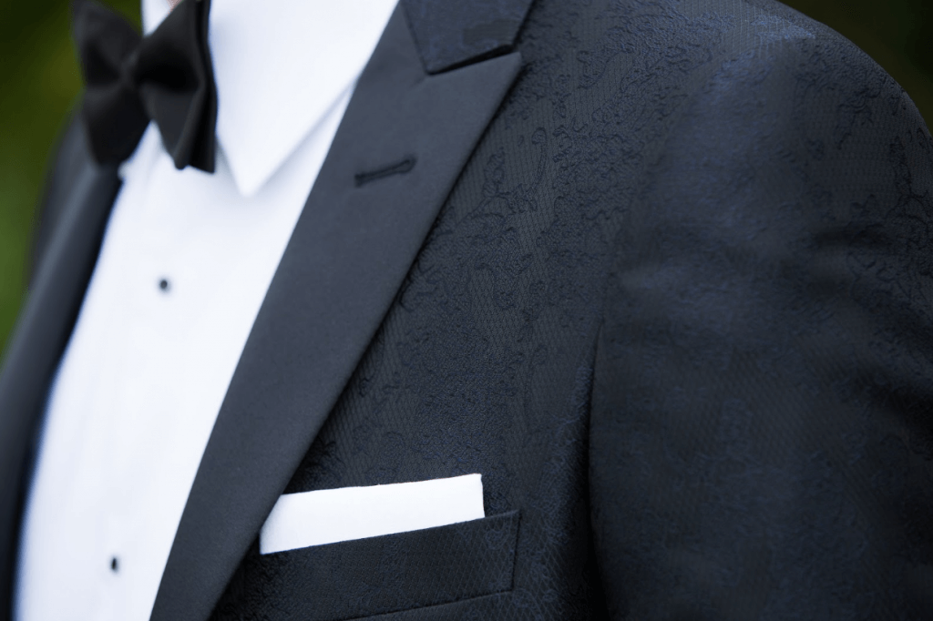 Close up shot of a textured detail on a tuxedo jacket.