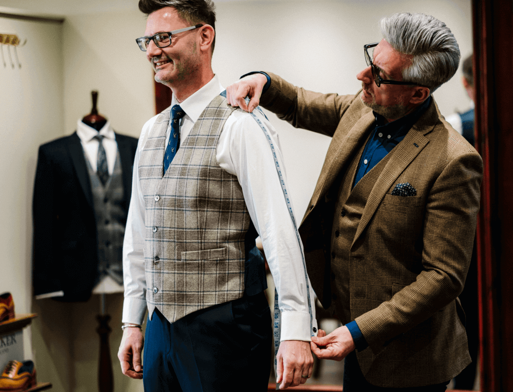 A groom to be has his fitting at Whitfield and Ward.