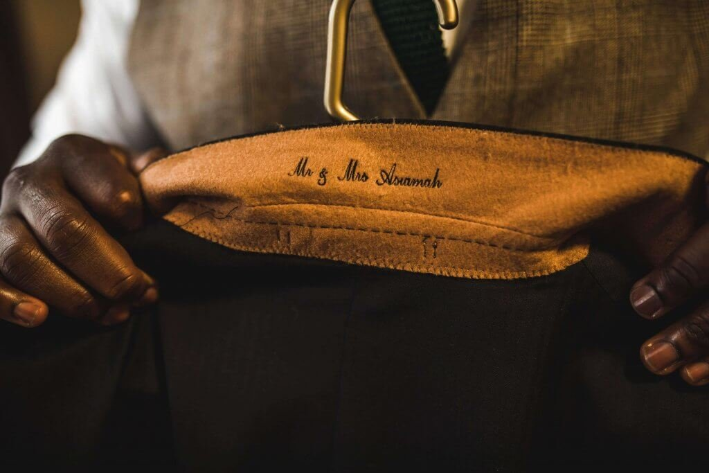 Close up shot of the personalisation of a suit jacket collar.