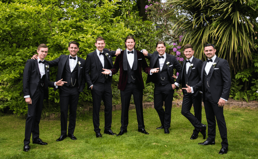 The groom and his ushers pose for the camera.