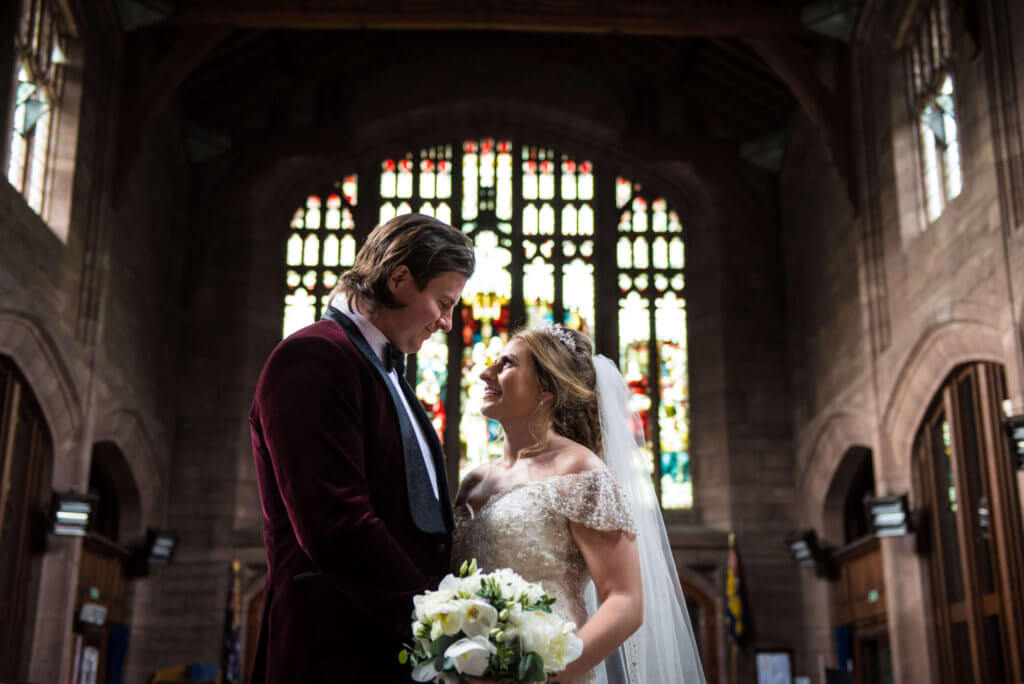 A close up shot of the bride and groom looking into each other's eyes in the church.