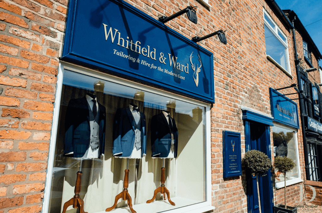 An outside shot of Whitfield and Ward, showcasing the suits in the window.