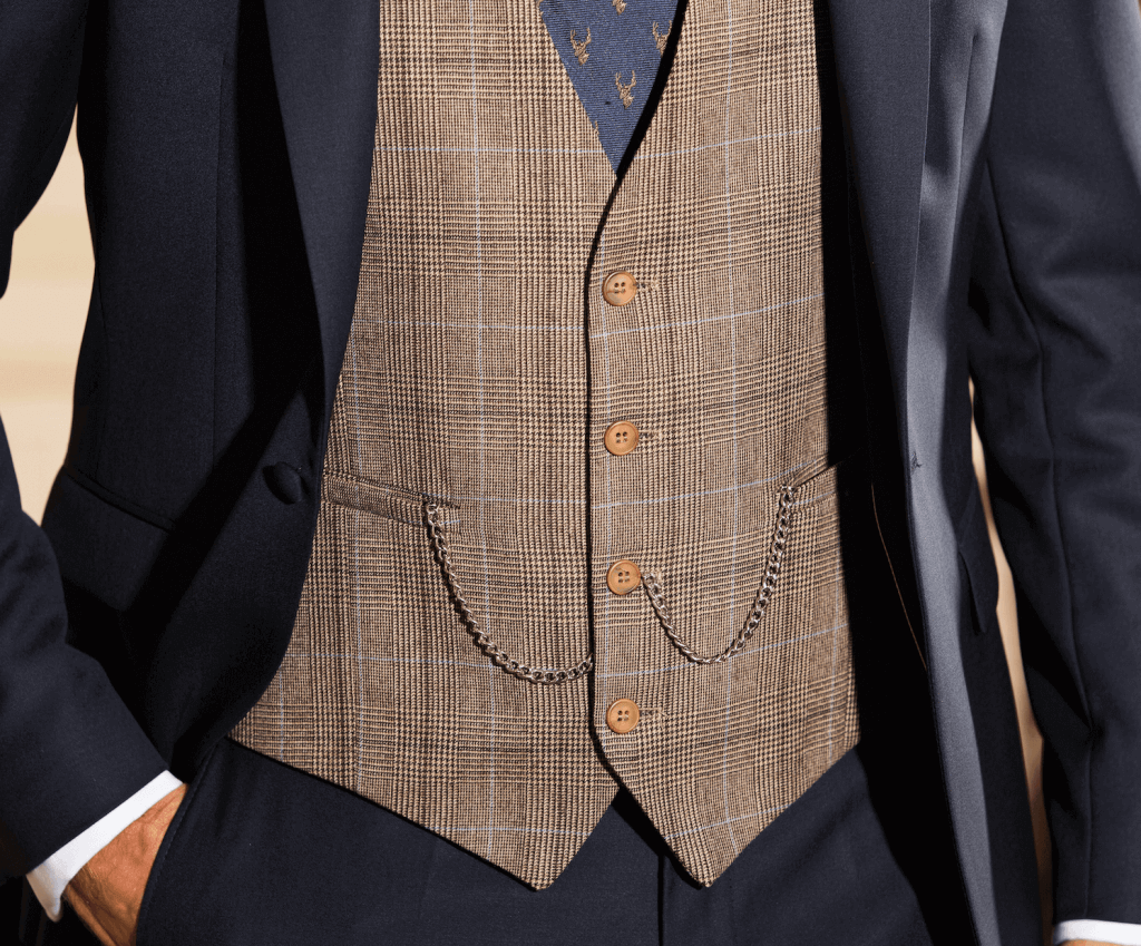 Close up shot of a beige checked waistcoat against a navy suit