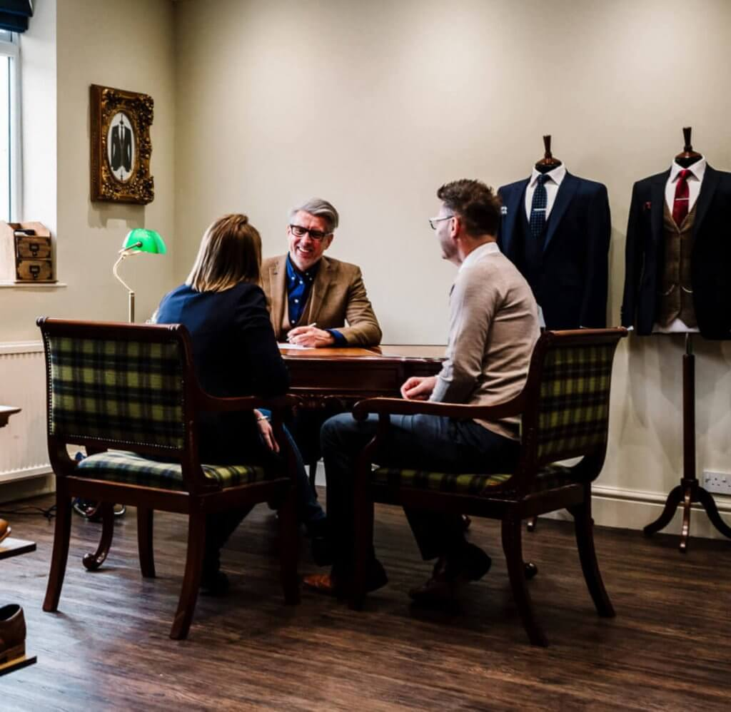Craig having a consultation about suits with his customers