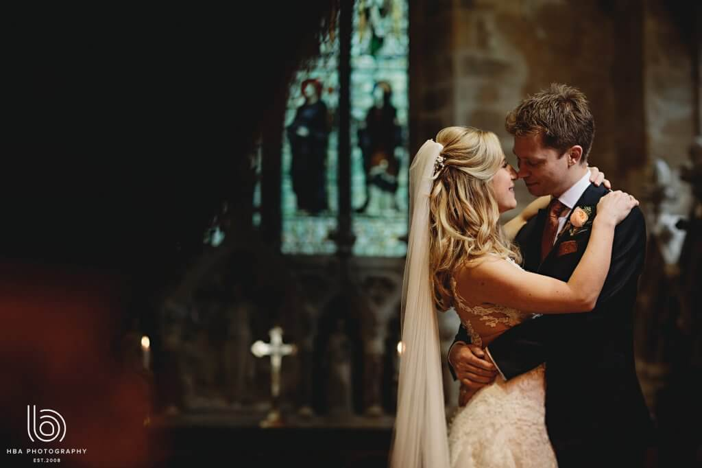 Bride and groom embracing each other in a church