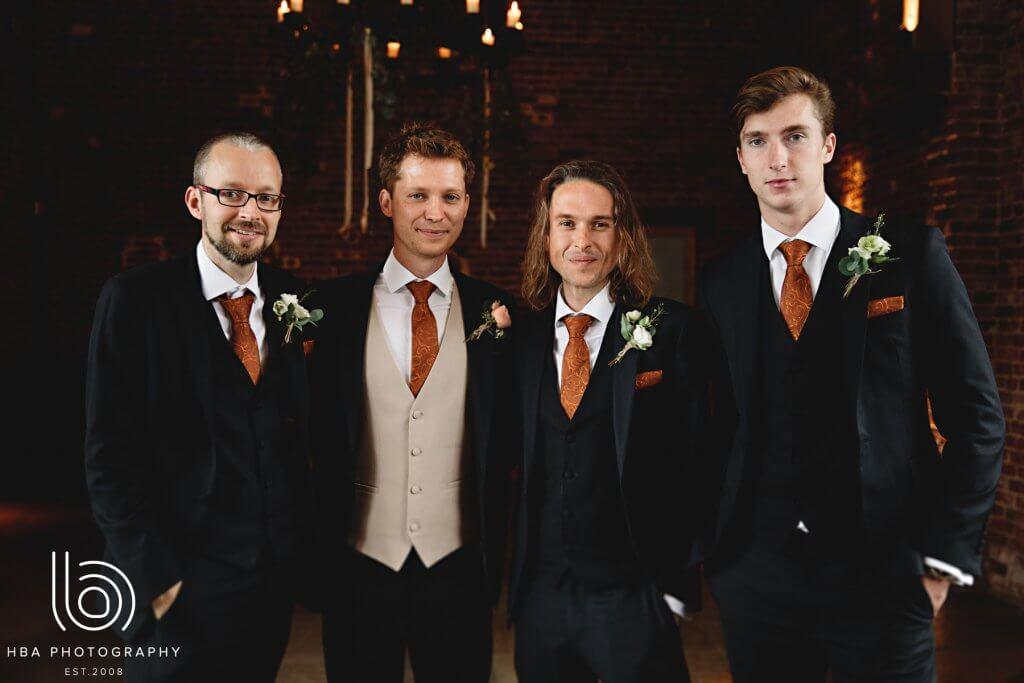 Groom & his groomsmen wearing navy lounge suits