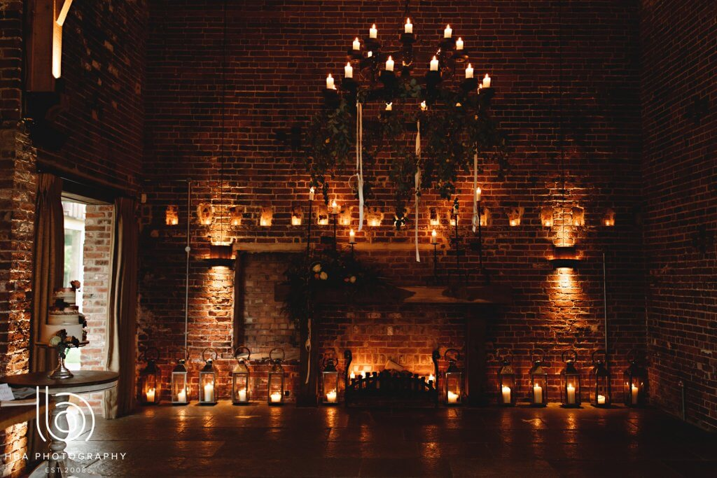 interior shot of a wedding barn with lots of candles burning