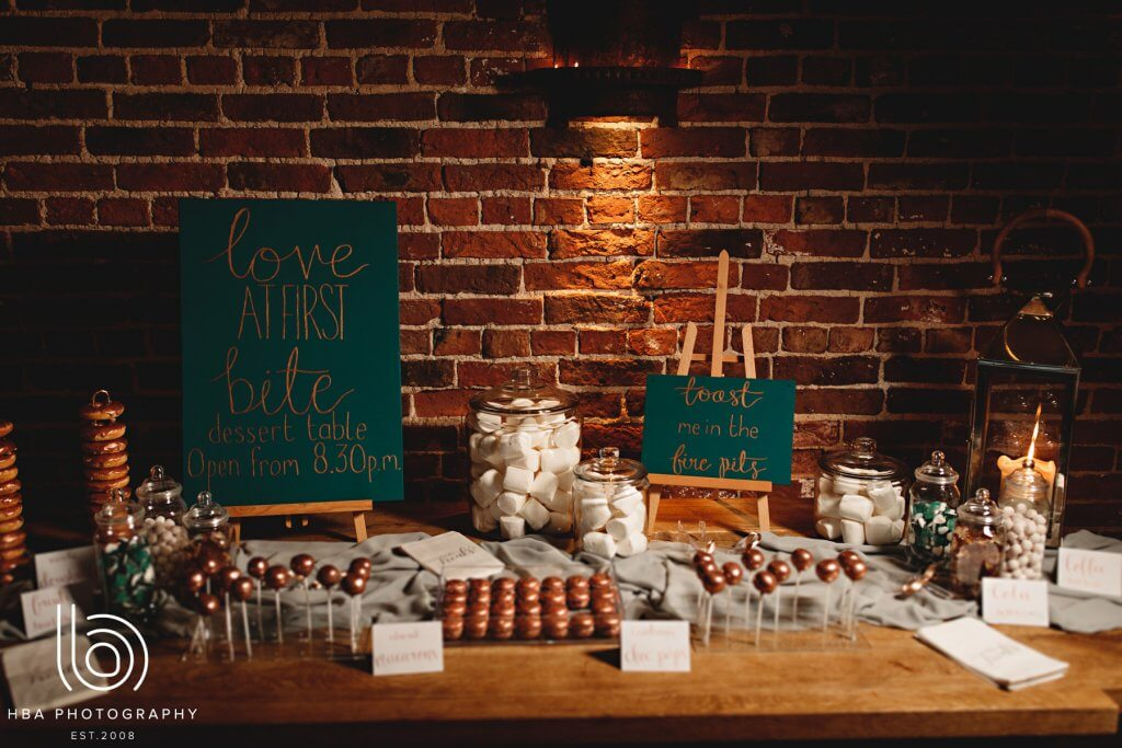 A copper and green themed dessert table