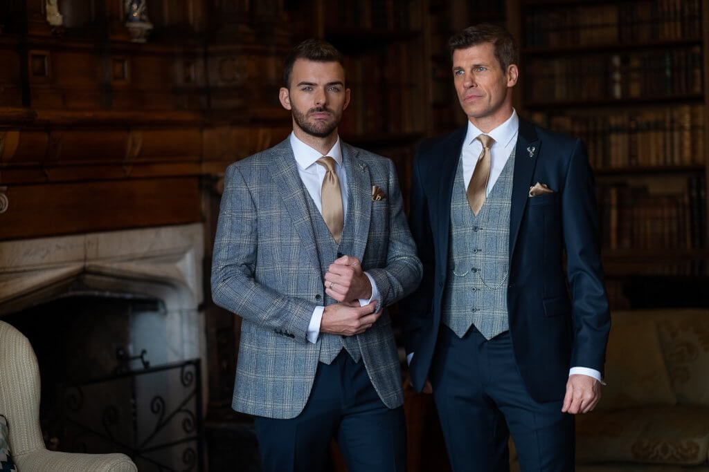 groom and groomsman in coordinating lounge suits